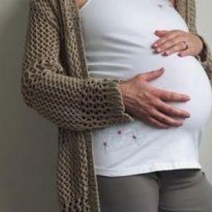 Болить живіт над пупком при вагітності